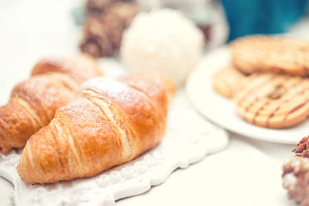 roomservice: Delicious and tasty fresh croissants as breakfast meal