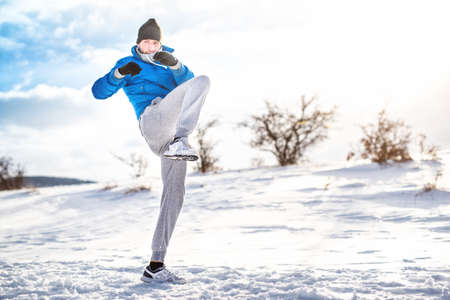 strenght: professional athlete working out and training outdoor Stock Photo