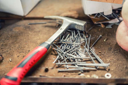 handy man: close-up of professional hammer, nails and construction tools on workbench Stock Photo