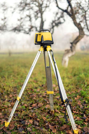 surveying: Surveying measuring equipment level theodolite on tripod