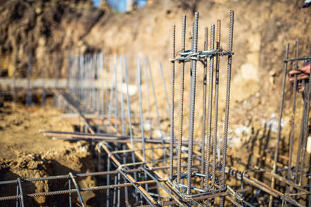 Detail of infrastructure - Reinforced steel bars on new construction foundation site