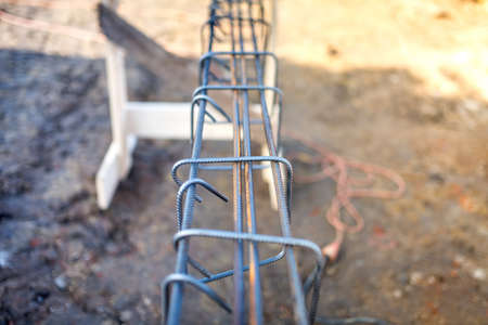 cable knit: Reinforced heavy duty steel bars on new construction foundation site, infrastructure details and tools