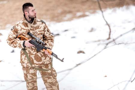 power rangers: Military trooper, ranger, holding a machine gun on the battlefield Stock Photo