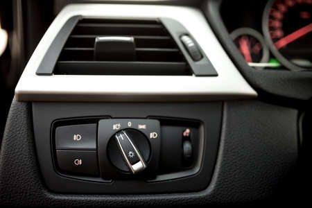 control panel lights: Air conditioning of automobile interior and headlight controls - modern car ventilation system.