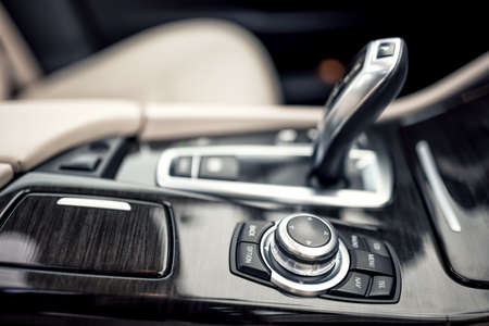 leather: Design details of minimalist concept of modern car -  close-up details of automatic transmission and gear stick