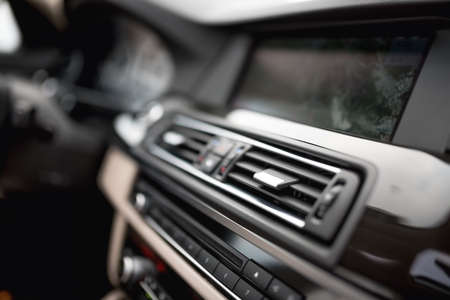 and the air: modern car interior with close-up of ventilation system holes and air conditioning. Concept wallpaper for auto air conditioning and dashboard Stock Photo