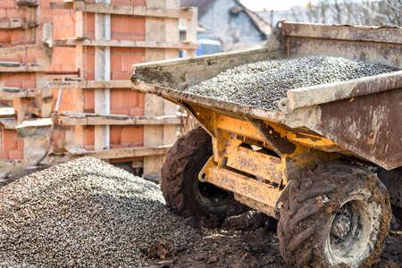dumptruck: Dumper truck unloading construction gravel, sand and crushed stones