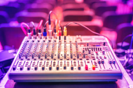 Audio music mixer and sound equalizer, dj equipment and nightclub accesories at party in modern city Stock Photo