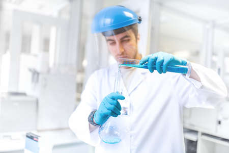 microorganisms: Scientist doctor using laboratory flask for taking samples from test tube and comparing results