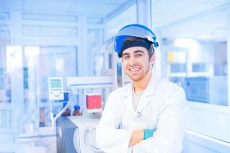 Male scientist in experimental laboratory using medical resources and tools photo