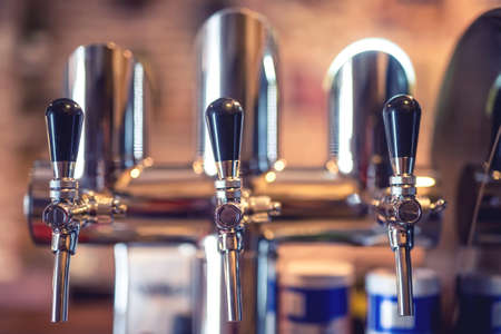 draught: Beer tap at restaurant, bar or pub. Close-up details of beer draft taps in a row Stock Photo