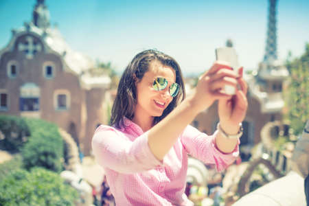 modern girls: Attractive woman takin selfie with smart phone, mobile phone. Modern concept of photography, selfie, beautiful woman taking pictures of herself Stock Photo