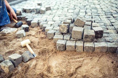 pavement: Paving stones on pavement terrace, construction details of cobblestone pavement blocks Stock Photo