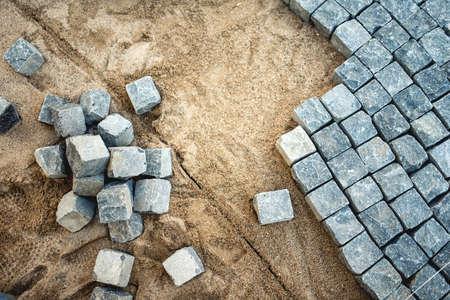 Pavement rotsen, stenen en geplaveide blokken, bouw van pad, weg of stoep