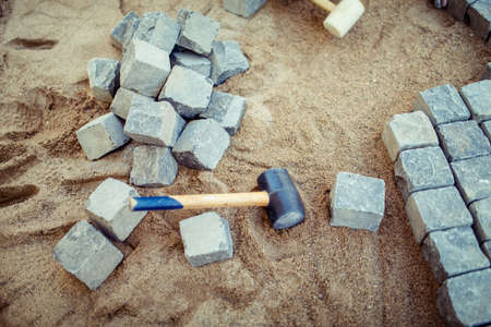 Stone Pavement Blocks, On Sand, With Tools And Construction Details. Laying  The Pavement
