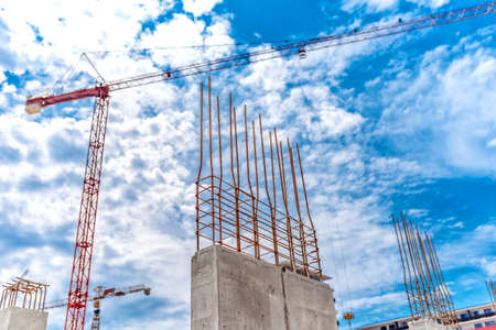 industrial building: Construction site with industrial crane and close up of reinforced concrete walls, building of skyscraper office building