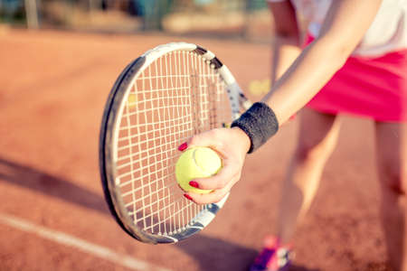 racquet: close up portrait of tennis racquet with fitness girl. healthy training for sportswoman details