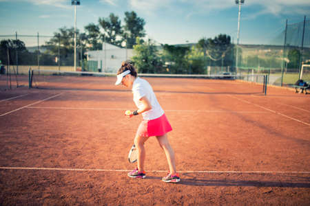 tennis clay: Woman playing tennis on clay court, with sporty outfit and healthy lifestyle