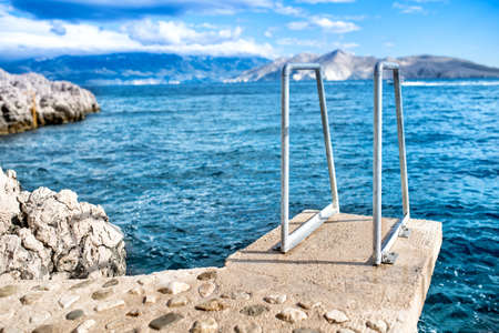 shore line: Blue sky and clear water, sea horizon and rocks on island wallpaper Stock Photo