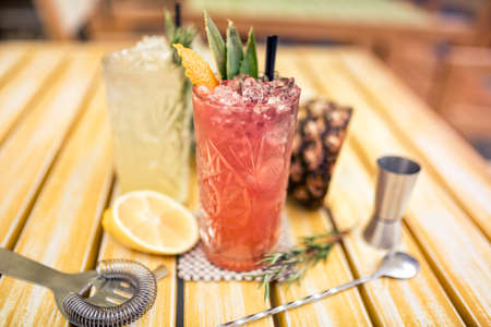 alcoholic cocktails served cold in bar, restaurant. Gin and tonic lime cocktails Stock Photo
