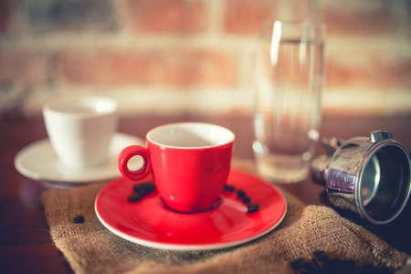hot temper: short espresso freshly brewed from coffee machine in pub, restaurant. Fresh coffee with details on vintage edit