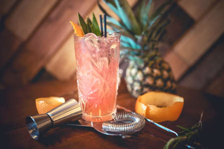 refreshment: strawberry alcoholic cocktail with lime and orange, served as refreshment drink in local pub