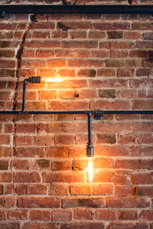 ambiance: home decoration walls with lamps, pipes and bricks. Old and vintage looking wall, interior design Stock Photo