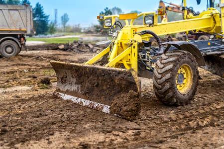 dumper truck: Excavator, dumper truck and bulldozer working on ground at construction site
