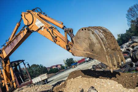 demolishing: industrial bulldozer demolishing buildings and working on construction site