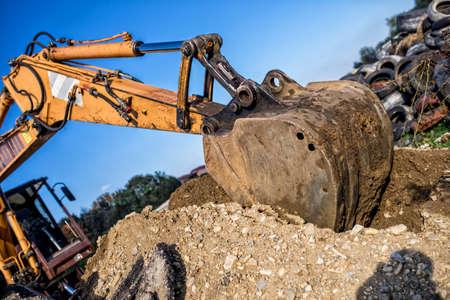 demolishing: demolishing operations at industrial construction site. worker using bulldozer wrecking