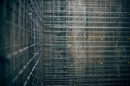reinforcing bar: reinforcement steel bars and wire rod, rebar on construction site. Concrete walls details before cement pouring Stock Photo