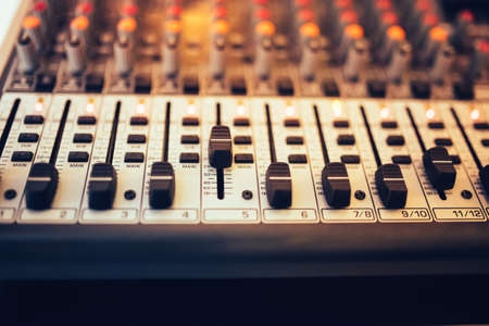 music production: Detail of a music mixer in studio, dj working for new tracks. Music production with editing tools