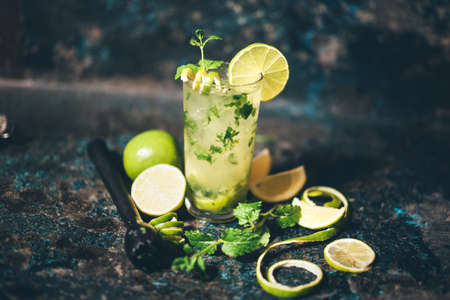 alcoholic drink: mojito cocktail with lemon and limes garnish. alcoholic drink at bar with vintage effect Stock Photo