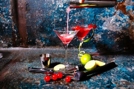 cranberry juice: bartender preparing cranberry juice and vodka - cosmopolitan alcoholic cocktail