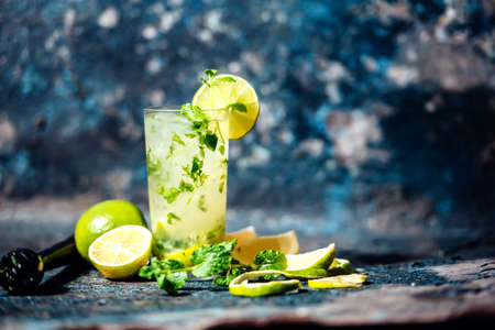 Refreshment cocktail with lime and ice. Mojito drink served at bar, pub or restaurant
