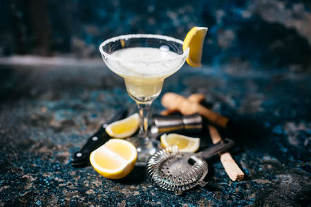 bartender: Fancy cocktail with lemons and vodka. Margarita refreshment drink and cocktails Stock Photo