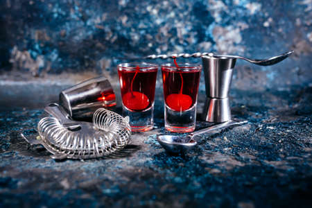 alcoholic beverage: Alcoholic beverage, strong cocktails with cherry and red vodka Stock Photo