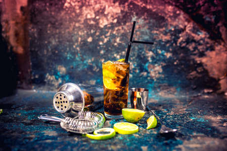 alcoholic drink: Alcoholic cocktail beverage, cuba libre drink with garnish and metal background
