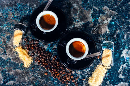 cups of coffee: cups of espresso with sugar and coffee beans Stock Photo