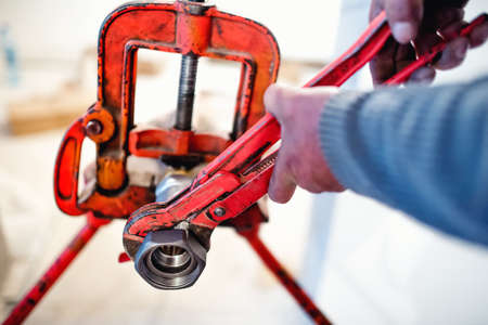 handy man: plumber working with wrench and tools