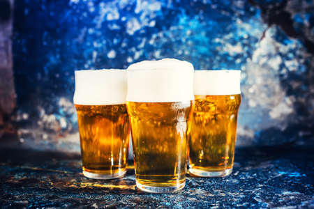 beers: Glasses of lager beer, light beers served cold at pub