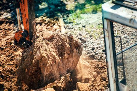 dumper truck: industrial truck loader excavator loading earth in dumper truck
