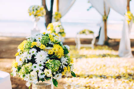 caribbean beach: Flower decoration, details of beach wedding set up. Romantic and private ceremony of bride and groom