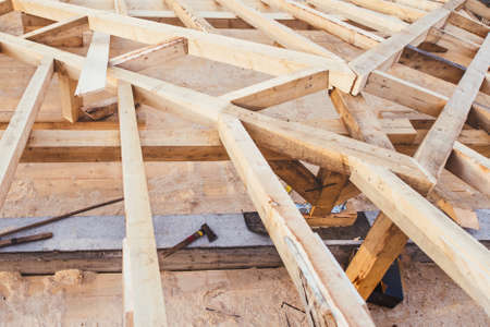 Wooden roof framework of new domestic, residential house - under construction details  Stock Photo