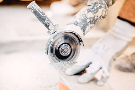 close up of industrial tool, grinder cutting piece of stone. Marble cutting at construction site