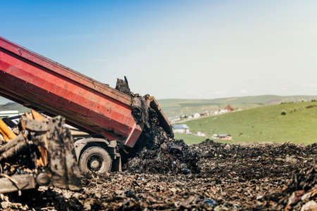 Dumping truck getting trash moved on construction site Stock Photo