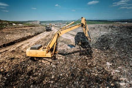 scrapyard: Industrial city waste dump yard details - excavator doing construction works