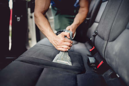 Close up details of car detailing - Cleaning and vacuuming car interior Stock Photo