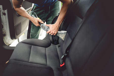 Car care concept, detailing and cleaning of interior back seats at luxury modern cars Stock Photo - 79274778