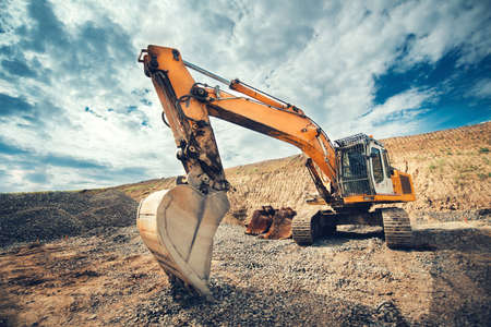 Close up details of industrial excavator working on construction site